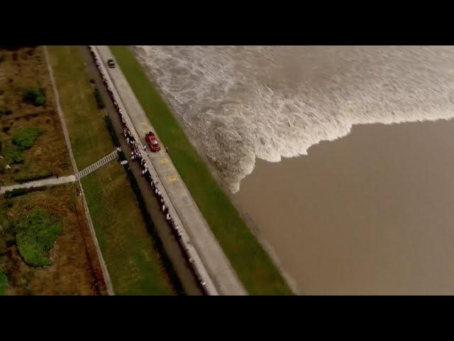 About 100,000 Visitors Watching Line Shaped Tidal Bore at Qiantang River