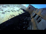 Airsoft player doesn't watch where he's going and falls off of a 2 story building