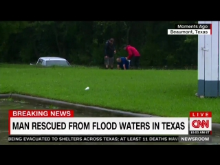 Cnn reporter pulls man from sinking truck - hurricane harvey