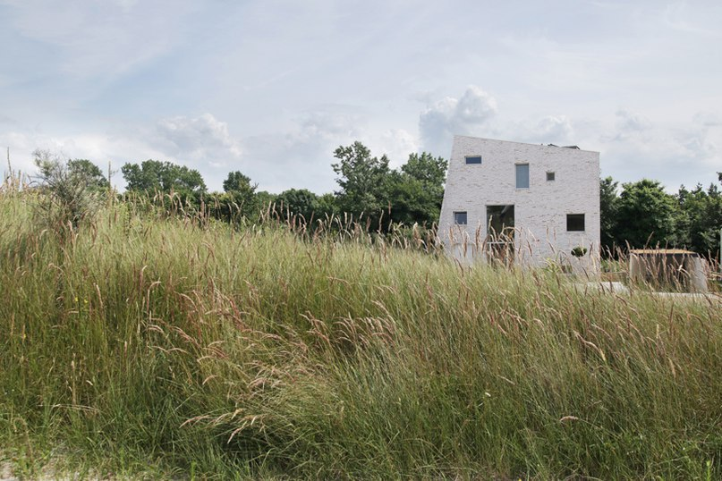 global architects' asymmetric rock house emerges from