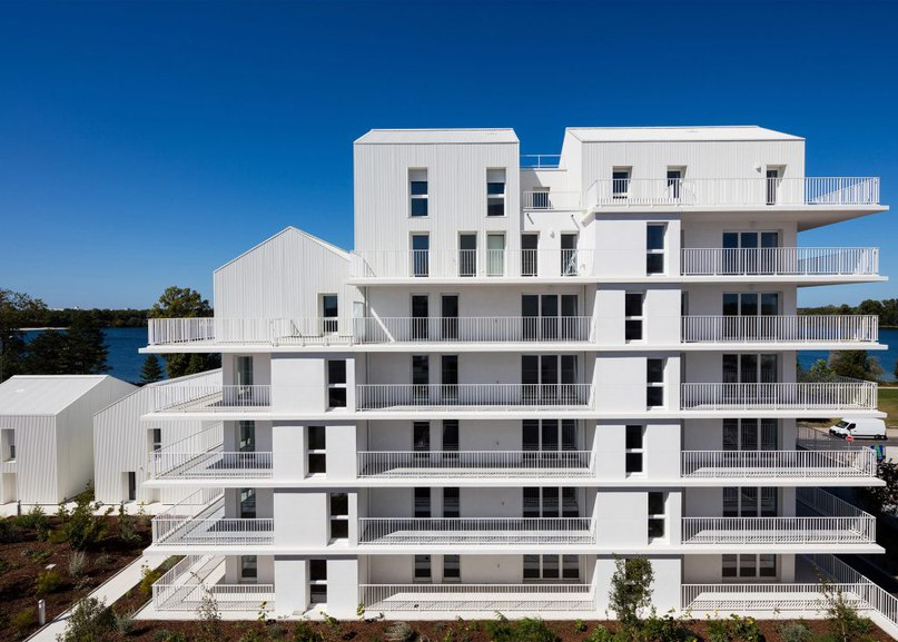 Gabled penthouses sit atop apartment blocks at