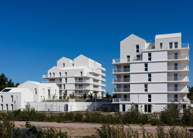 Gabled penthouses sit atop apartment blocks at