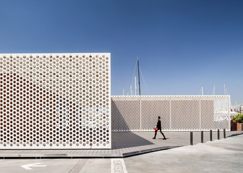 Perforated screens cover Barcelona marina buildings by