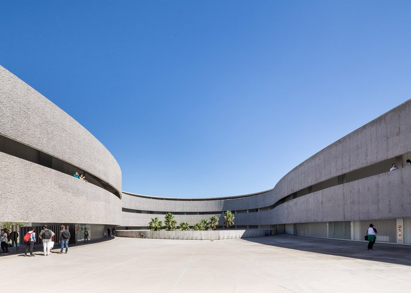 Bands of corduroy-textured concrete wrap GPY Arquitectos'