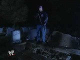 Undertaker in graveyard