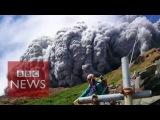 Video Japan volcano shoots rock