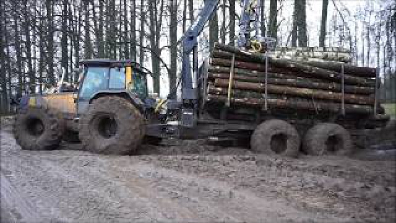 Valtra forestry tractor with big fully loaded trailer in wet conditions