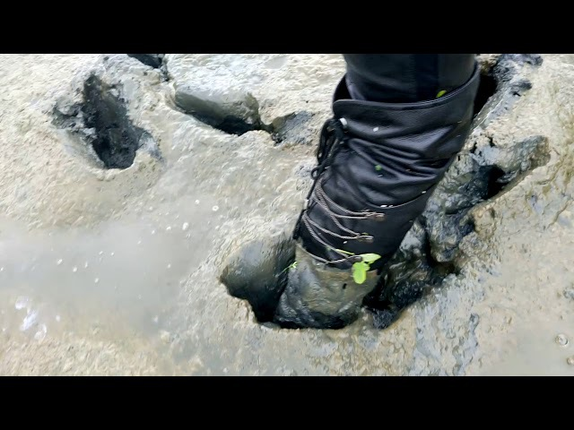 Girl in wet high 65 cm leather boots in leather trousers walks in the deep mud part4 MOV 0133