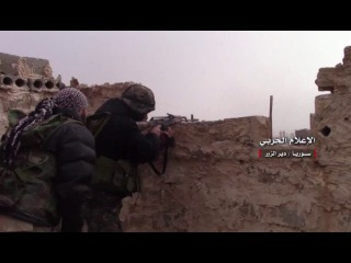 Heavy fighting between the Syrian army and the terrorists Daesh in the cemetery and the area around the city of Deir ez-Zor