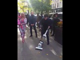 Wife of Ice T  'Coco' walking down West Broadway with a man vacuuming the street before her