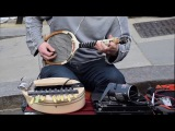Street Musician playing hit the road jack with a tennis racket