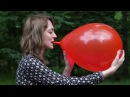 Real looner girl blowing up and popping big balloons