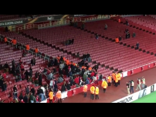 Kln fans fighting with stewards inside the stadium.