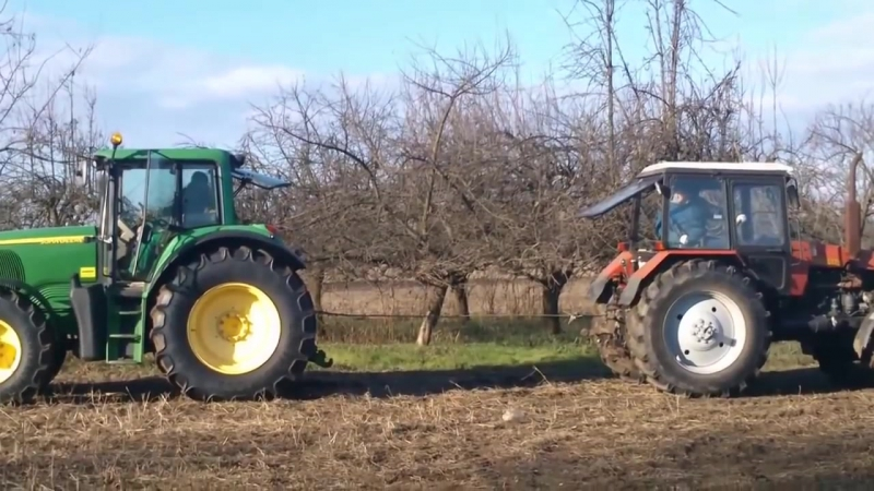 Битва тракторов – MTZ Беларус 1221 vs John Deere 6820, кто кого