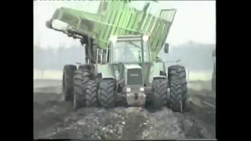 Трактора в поле, грязь по раму.