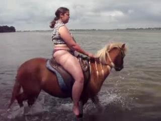 Powerful Latin señorita rides horseback