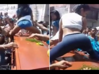 Two Young Women TWERK and Grind Over a Coffin at a Funeral to Honour Dead Reggaeton Fan [VIDEO]!!