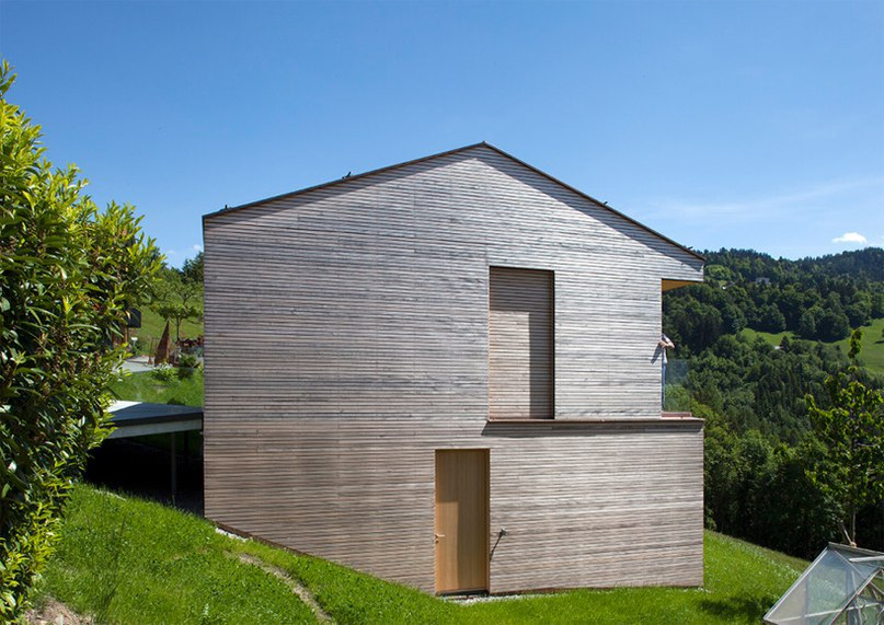 dietrich | untertrifaller recesses garage into wooden