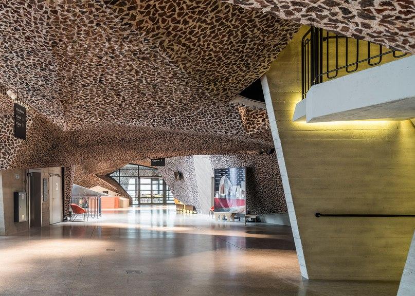 Fernando Menis combines crushed brickwork and concrete