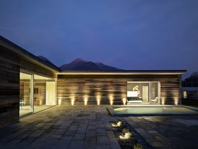 Streamlined Home in Italy Rocks Stone Surfaces