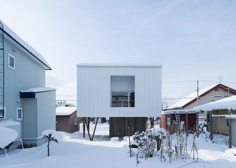Top-heavy house by Archi LAB designed to