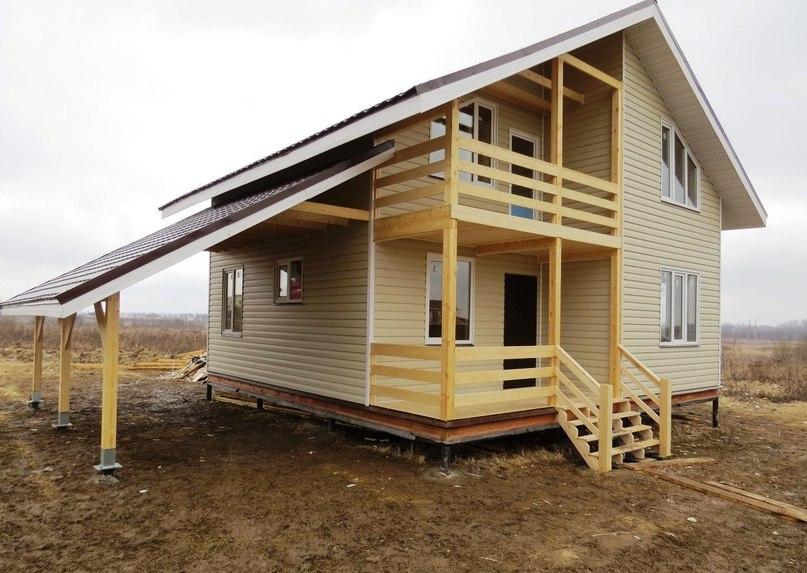 Двухэтажный дом с навесом  Площадь дома: 130 м²