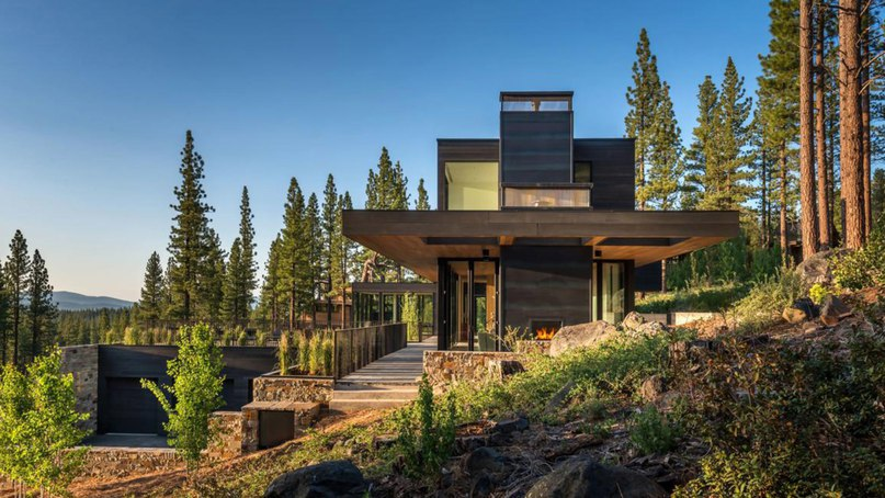 Californian home by Blaze Makoid steps down a forested hillside