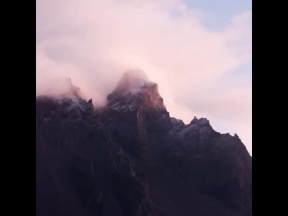 Morning Bliss . Dawn 's early light illuminating the clouds and mountain at Stokksnes , Iceland . Music: @monoofjapan timelapse