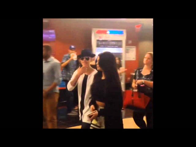 Justin Bieber Selena Gomez leaving a theatre in Los Angeles June 20, 2014