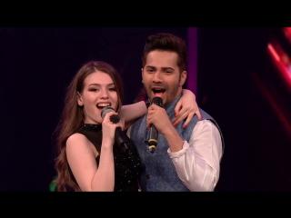 Варун Дхаван и участница из России Люся Чеботина исполняют песню