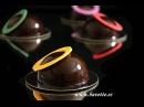 Semi Esferas de chocolate maracuyá y glaseado espejo