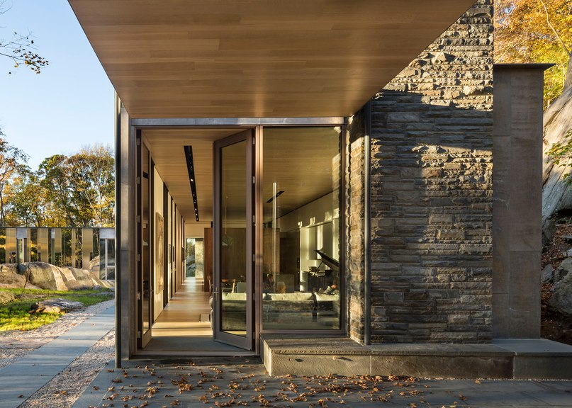 Pound Ridge House by KieranTimberlake reflects its surroundings with a mirrored facade