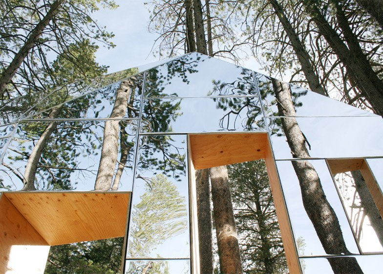 Invisible Barn is a mirror-clad folly camouflaged among the trees of a California forest