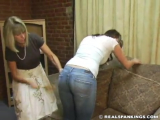 Mrs Daniels spanks Jackie with a wooden spoon