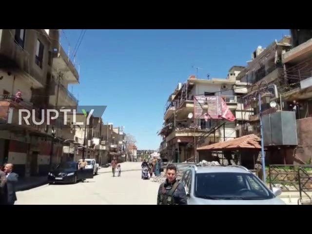 Сирия: Сотни эвакуированных из осажденного города Мадая.