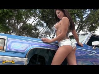 Model Monica Precie shows her microbikini at Car Show in Wilmington, Ca.