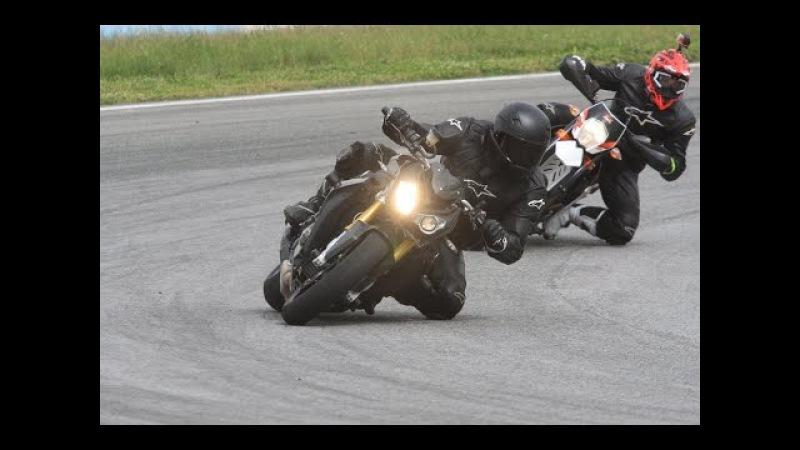 BMW S 1000 R, KTM 690 SMC R, Honda CBR 1000 RR Repsol on a race track
