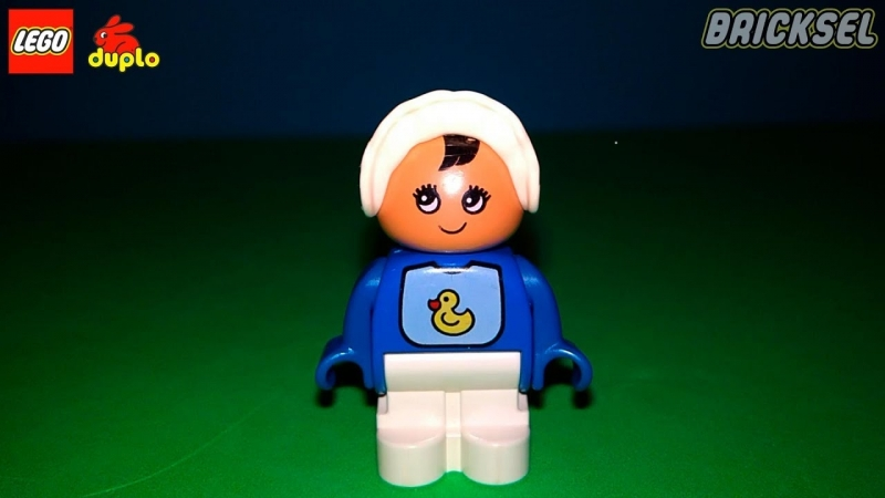 Младенец. Фугрки LEGO DUPLO. Обзор. Младенец в слюнявчике с утенком. Лего дупло фигурка младенца.