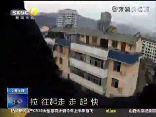 Husband saves suicidal wife from jumping off building by grabbing her ponytail at the last second