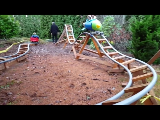 Initial run of the Red Racer backyard roller coaster cart on the little rocket track.