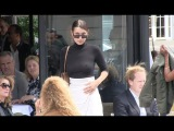 EXCLUSIVE - Bella Hadid having a coffee and a cigarette on the terrace of l Avenue in paris