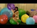 Girl blow to pop big balloons