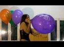 Girl blow to pop big balloon