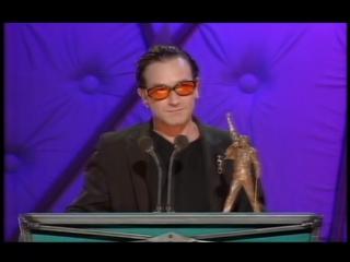 Jubilee 2000 win the Freddie Mercury Award presented by Johnny Vaughan. BRIT Awards 1999