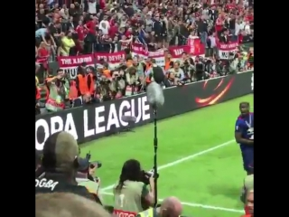 Paul Pogba celebrates with the fans last night