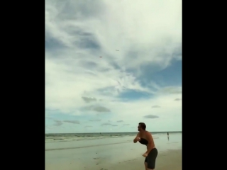 Professional frisbee player having fun at the beach