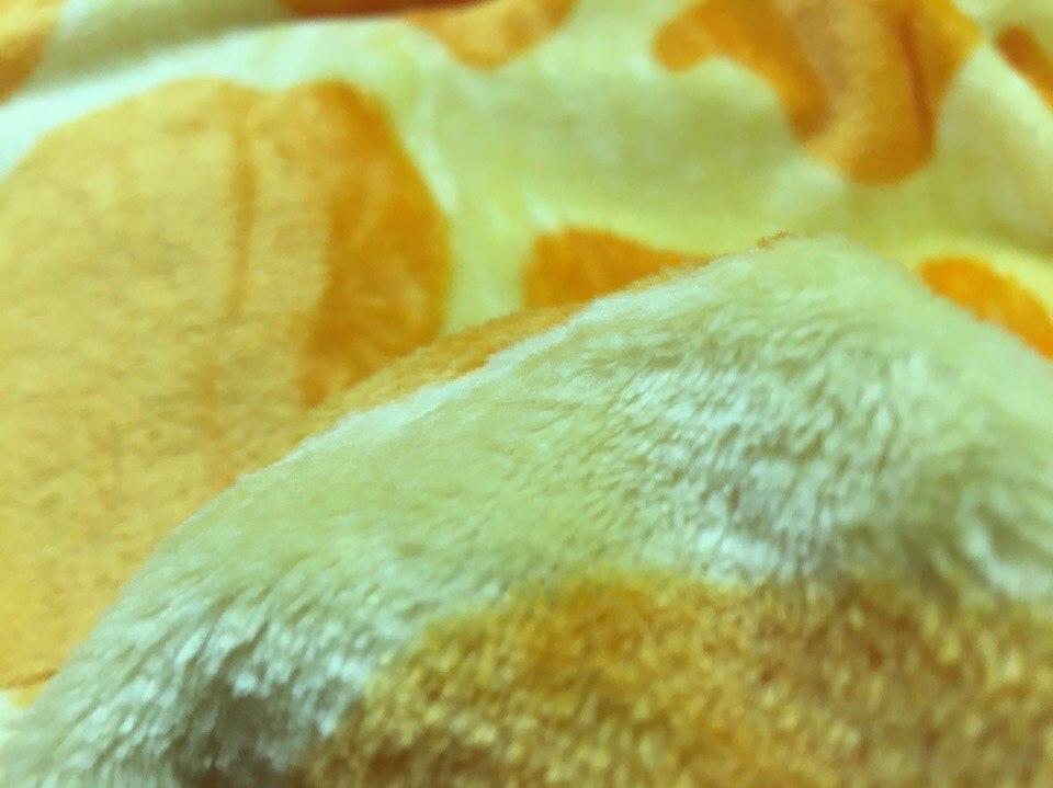 фотография ткани велсофт у пижамы кигуруми жираф