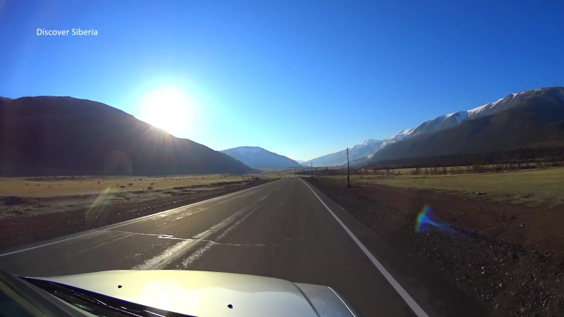 Road in the mountains. Towards the sun Aktash to Kuray. Altai Republic, Siberia, Russia (Full HD)
