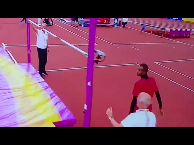 Qatar's Mutaz Essa Barshim hurdles 6'4 high jump bar.