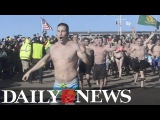 New Yorker's brave the freezing water at Coney Island Polar Bear Plunge